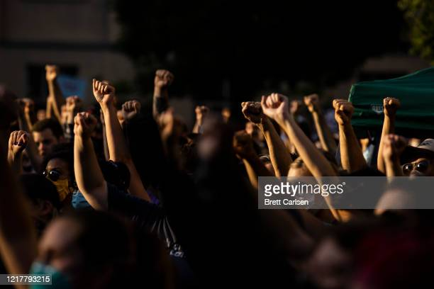 Protesters raise their fists in solidarity while listening to a speaker on June 5, 2020 in Louisville, Kentucky. Protests across the country continue...