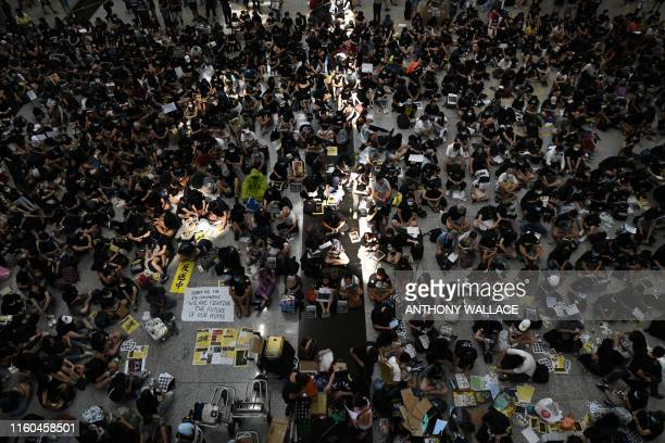 TOPSHOT Protesters rally against a controversial extradition bill at Hong Kongs international airport on August 9 2019 Hundreds of prodemocracy...