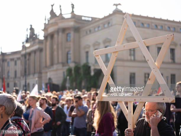 Protesters rally against antisemitism on October 13 2019 at Bebelplatz square in the centre of Berlin in a reaction to the Halle shooting Two people...