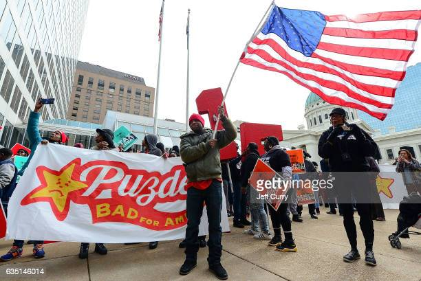 Protesters rally against Labor nominee Andrew Puzder at Hardee's Headquarters on February 13 2017 in St Louis Missouri The protesters feel that Mr...