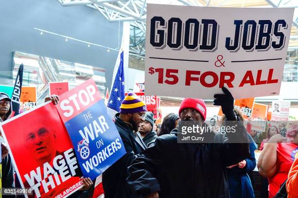 Protesters rally against Labor nominee Andrew Puzder in the lobby of Hardee's Headquarters on February 13 2017 in St Louis Missouri The protesters...