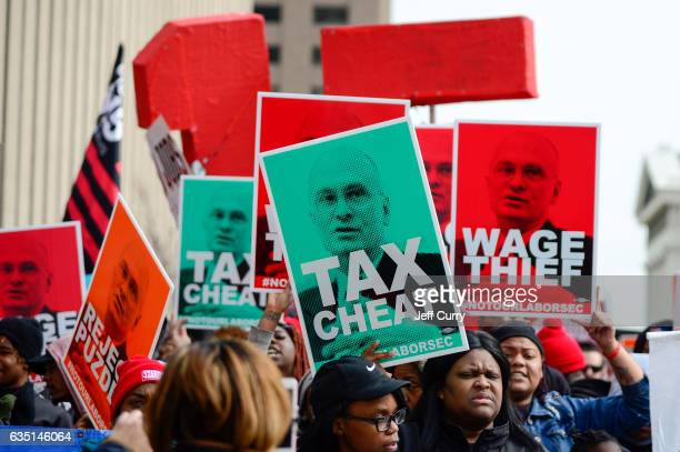 Protesters rally against Labor nominee Andrew Puzder outside of a Hardee's restaurant on February 13 2017 in St Louis Missouri The protesters feel...