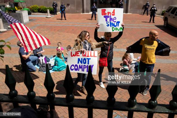 Protesters rally against stayathome orders related to the coronavirus pandemic outside Capitol Square in Richmond Virginia on April 16 2020 After...