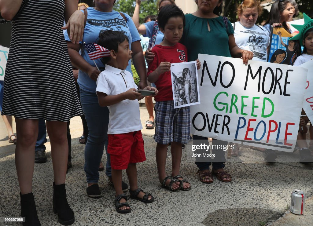 Protesters rally against the separation of immigrant families in front of a U.S. federal court on July 11, 2018 in Bridgeport, Connecticut. The rally was in support of two Central American children separated from their parents as a result of the Trump administration's 'zero tolerance' policy on undocumented immigration at the southern border. The two children, who are reportedly being held in a facility in Groton, CT were to appear at a court hearing ahead of possible reunification with their parents.