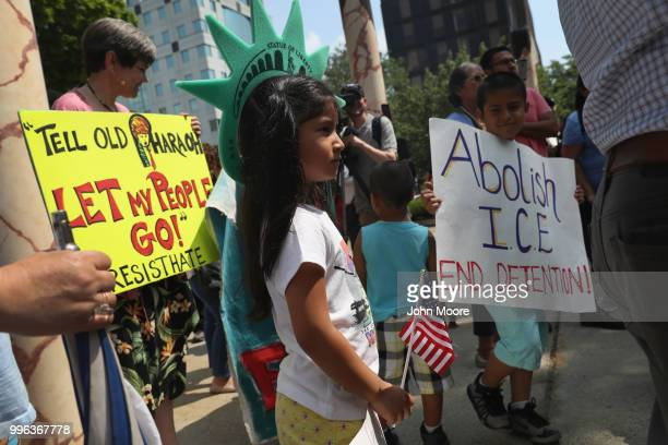 Protesters rally against the separation of immigrant families in front of a US federal court on July 11 2018 in Bridgeport Connecticut The rally was...