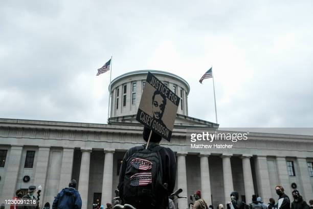 Protesters rally at the Ohio State House in downtown Columbus in protest of the fatal shooting of Casey Goodson Jr. By a Columbus Police Officer on...