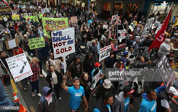Protesters rally down Queen Street on April 28 2012 in Auckland New Zealand Thousands of antiasset sale protesters marched opposing to the sale of...