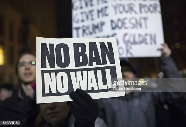 Protesters rally during a demonstration against the new immigration ban issued by U.S. President Donald Trump, outside the Brooklyn Court House on...