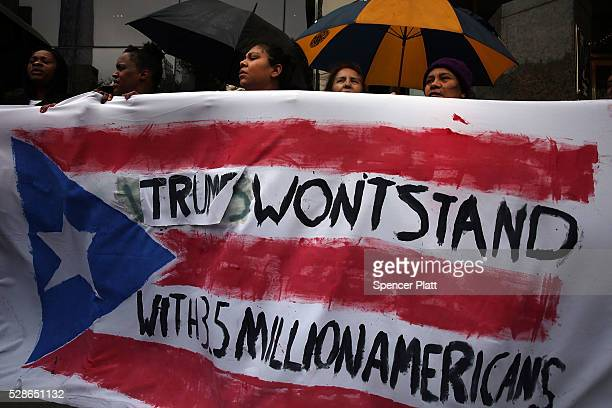 Protesters rally in front of a Trump owned hotel in Manhattan on May 06 2016 in New York City The protesters many of them Latino and Puerto Rican...