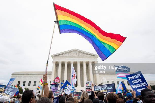 Protesters rally in front of the Supreme Court as it hears arguments on whether gay and transgender people are covered by a federal law barring...