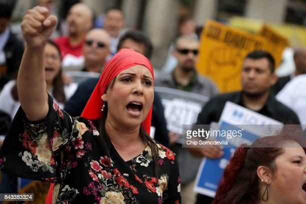 Protesters rally in Indiana Square before marching to the Department of Justice to demonstrate against the Trump Administration's decision to end the...