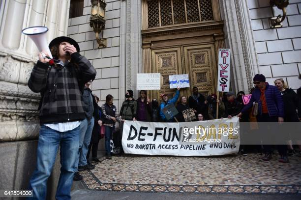 Protesters rally outside a US Bank which closed its doors to speak out against the investment in the Dakota Access Pipeline in Portland Oregon United...