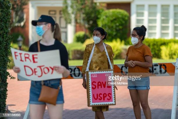 Protesters rally outside the home of USPS Board of Governors John M Barger to decry recent US Postal Service cuts by Postmaster General Louis DeJoy...
