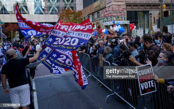 Protesters rally outside the Pennsylvania Convention Center where election votes are being counted in Philadelphia, Pennsylvania, on November 5,...