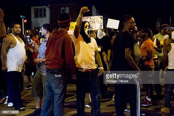 Protesters rally through the streets the day after a fatal police involved shooting Sunday Aug 14 in Milwaukee Wis