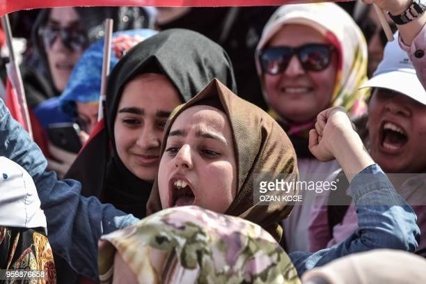 Protesters react as they listen to the speech of the Turkish President during a protest rally in Istanbul on May 18 against the recent killings of...