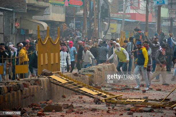 Protesters react during demonstrations against India's new citizenship law in Meerut on December 20, 2019. - Five more protesters died in fresh...