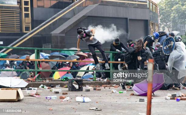 Protesters react on teargas fired to them by the police during the demonstration Police surround the Polytechnic University after prodemocratic...