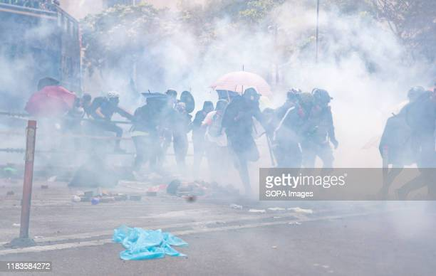 Protesters react to teargas fired on them by the police during the demonstration Police surround the Polytechnic University after prodemocratic...
