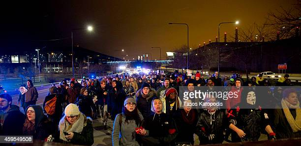 Protesters react to the St. Louis grand jury decision not to indict Ferguson Police Officer Darren Wilson in the shooting death of Michael Brown...