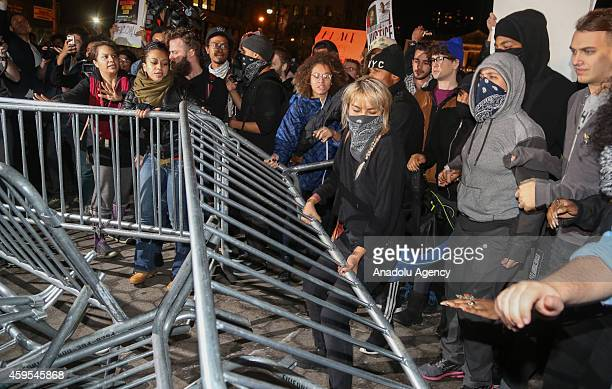 Protesters remove barricades as they marched from Union Square to Times Square after learning at police officer Darren Wilson of the Ferguson MO...