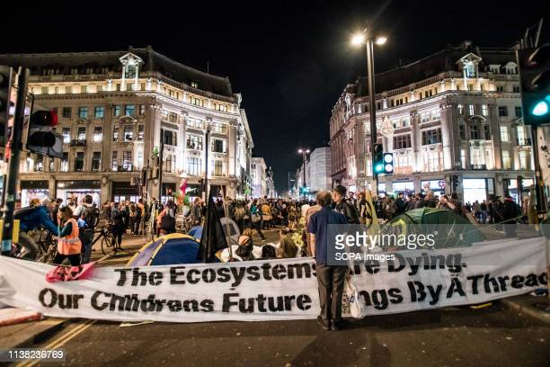 Protesters reoccupied Oxford Circus after the police removed the boat Berta Cáceres during the Extinction Rebellion Strike in London Hundreds of...