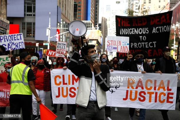Protesters representing various socio-economic groups rally against climate change on September 20, 2020 in New York City. The connection between...
