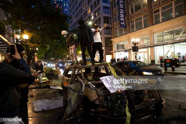 Protesters riot in the streets following a peaceful rally expressing outrage over the death of George Floyd on May 30, 2020 in Seattle, Washington....