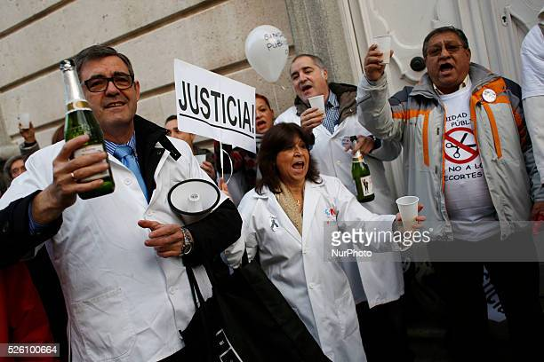 Protesters rise plastic glasses filled with 'Sidra' while doctors and patients celebrate the High court of justice of Madrid's judgment about the the...
