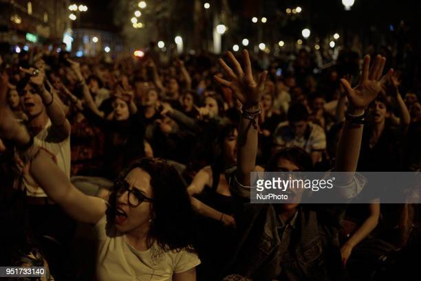 Protesters rise their hands during a protest in Madrid on 26 April 2018 The High Court of Navarra has given a sentence of 9 years in prison to five...