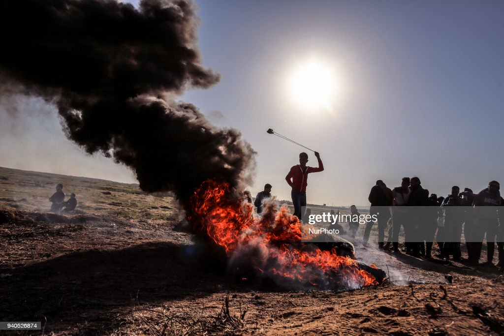 Protesters run during clashes with Israeli security forces following a demonstration near the border with Israel the southern Gaza Strip on March 31, 2018. The UN Security Council heard fears of a further escalation in Israeli-Palestinian violence in the Gaza Strip during emergency talks Friday despite a failure to agree a joint statement on deadly clashes.