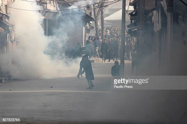Protesters running for cover after police fired tear gas towards them during clashes Soon after Friday prayers people in large number assembled at...