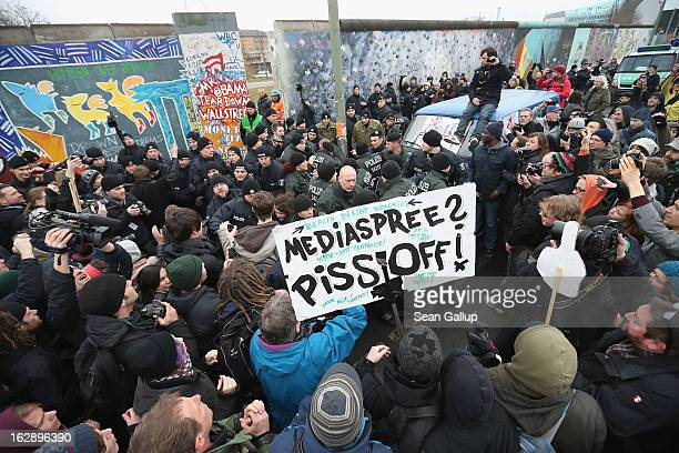 Protesters scuffle with police at the East Side Gallery which is the longest stillstanding portion of the former Berlin Wall during efforts by a...