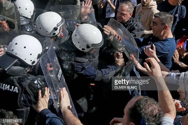 Protesters scuffle with police forces during a demonstration against Serbian President Aleksandar Vucic outside the presidential building in Belgrade...