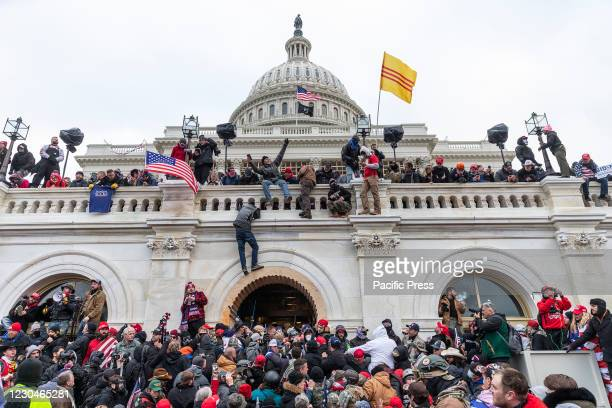 Protesters seen all over Capitol building where pro-Trump supporters riot and breached the Capitol. Rioters broke windows and breached the Capitol...