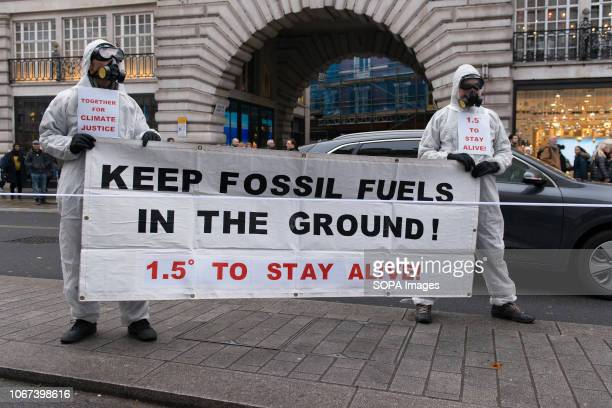 Protesters seen carrying a big banner Hundreds of people rallied in Portland Place near to the Polish embassy and marched to Downing Street in a show...