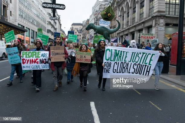 Protesters seen carrying banners and placards Hundreds of people rallied in Portland Place near to the Polish embassy and marched to Downing Street...
