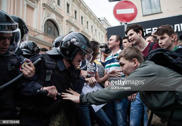 Protesters seen clashing the the police Anticorruption protest organised by opposition leader Alexei Navalny at Tverskaya Street
