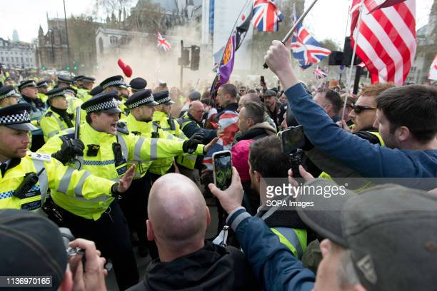 Protesters seen clashing with police during the demonstration Protesters gathered at Parliament Square and marched to different places including...