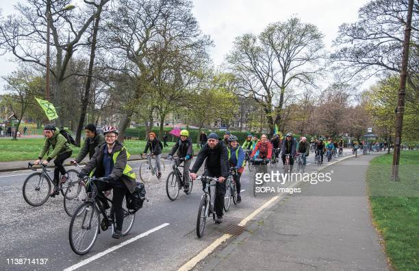 Protesters seen cycling during the demonstration Extinction Rebellion held a lockdown of Edinburgh's North Bridge as part of an international...