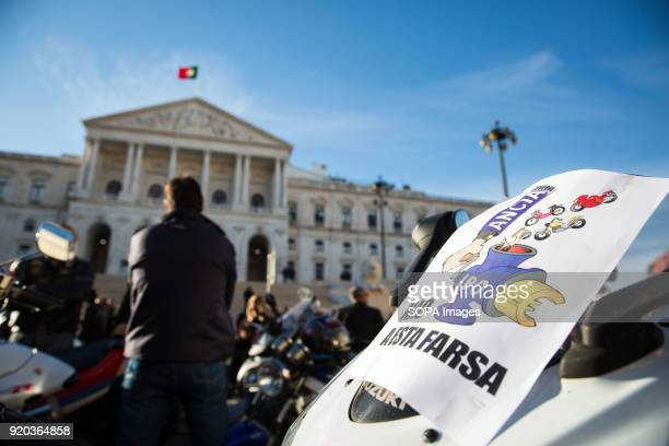 Protesters seen displaying placard in front of their motorbike Thousands of motorcyclists demonstrated in several cities in Portugal to protest...