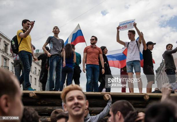 Protesters seen displaying placards and the Russian flags during the protest Anticorruption protest organised by opposition leader Alexei Navalny at...