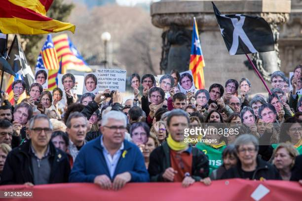 Protesters seen holding a large banner during a demonstration to support Carles Puigdemont former Catalan President in front of the Catalonia...
