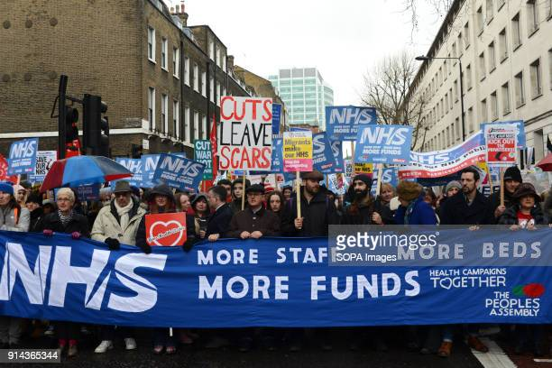 Protesters seen holding a large banner during the demonstration Thousand of people marched in London in a protest called NHS in crisis fix it now to...