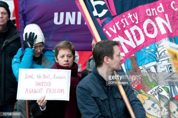 Protesters seen holding a signs during a demonstration against the 'Brexit Betrayal March' Thousands of people took to the streets in central London...