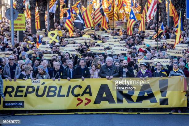 Protesters seen holding banners and the catalonia independence flag during the demonstration Tens of thousands of Catalans attended a demonstration...