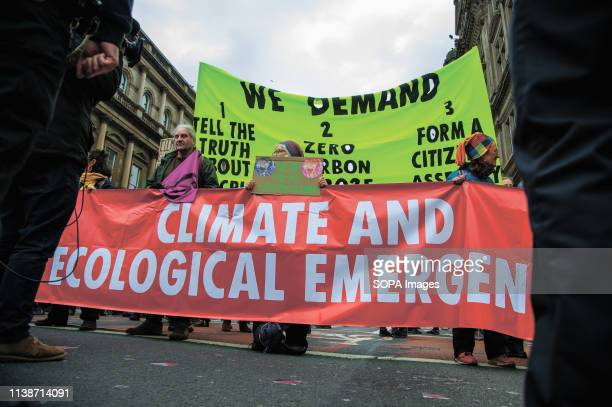 Protesters seen holding banners during the demonstration Extinction Rebellion held a lockdown of Edinburgh's North Bridge as part of an international...