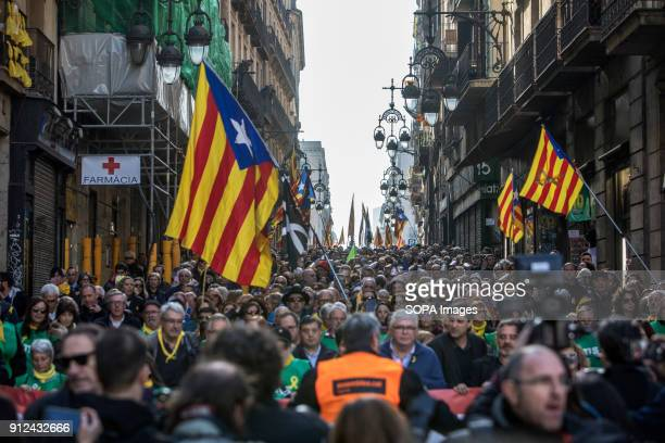 Protesters seen holding catalonia flags during a demonstration to support Carles Puigdemont former Catalan President in front of the Catalonia...