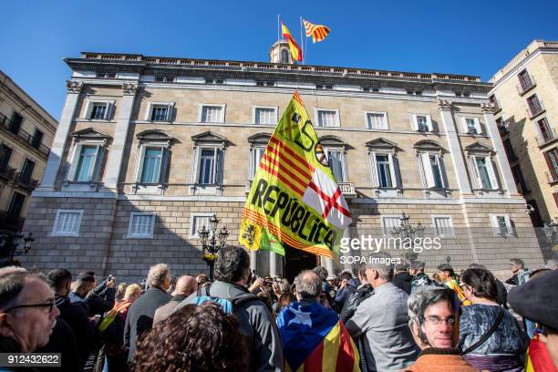 Protesters seen holding flags during a demonstration to support Carles Puigdemont former Catalan President in front of the Catalonia Parliament in...