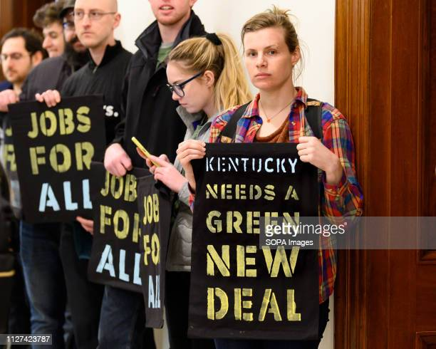 Protesters seen holding placards at the office of US Senator Mitch McConnell during the demonstration The Sunrise Movement organized a protest to...